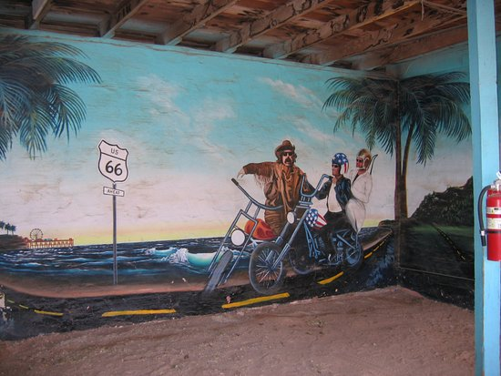 Tucumcari, NM: Mural on wall in garage between rooms 11 and 12
