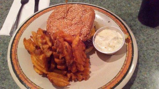 Vango's Pizza: 1/3 burger patty on sesame seed bun (added onions), seasoned waffle fries, dipping sauce