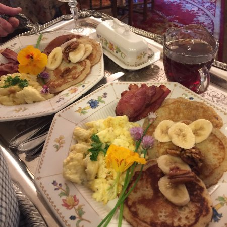 Manti, UT: Banana Pecan Pancakes with pure organic maple syrup going up to honeymooners on a silver tray.