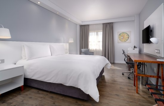 Protea Hotel Roodepoort by Marriott: Standard King-guest room features a relaxing area to work, watch TV, or read a book