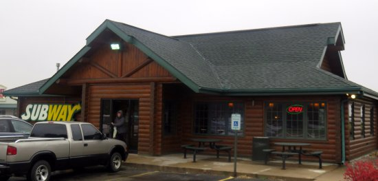 Stockton, IL: entrance to Subway - the log cabin