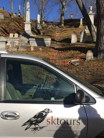 SK Tours Of Maine, LLC: The SK Tours van parked in the cemetary where scenes from Pet Sematary were filmed