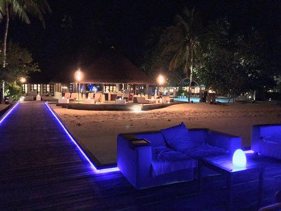 Four Seasons Resort Maldives at Kuda Huraa: Electric over-water lounge looking at the lobby.