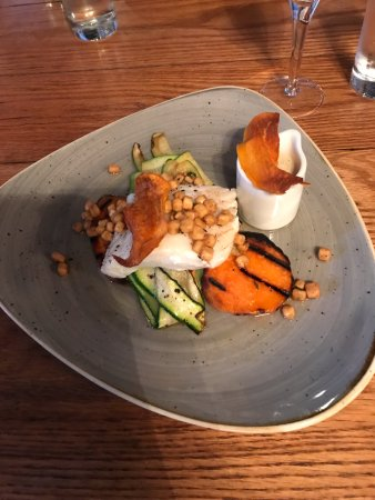 Axminster, UK: Cod with sweet potato, squid and courgette ribbons