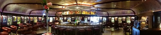 Harvey's Point: The absolutely beautiful bar.  Circular center bar with stools, and table seating all around.
