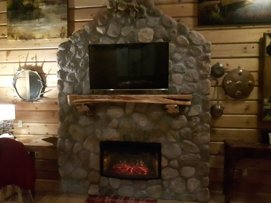 Retro Suites Hotel: Custom stone fireplace