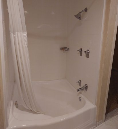 The Beverly Hilton: Funky tub has too high water pressure that turns your skin red. The tub is so awkward for shower