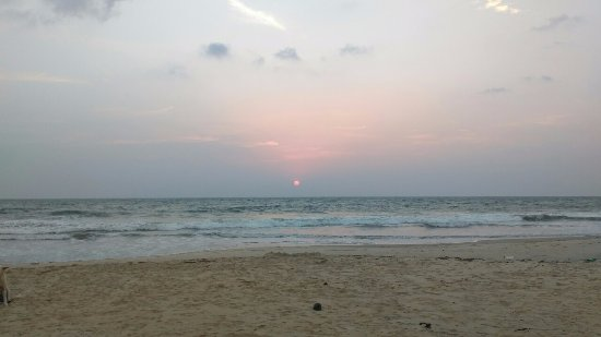 Honnavar, India: sunset at apsarakonda waterfalls beach
