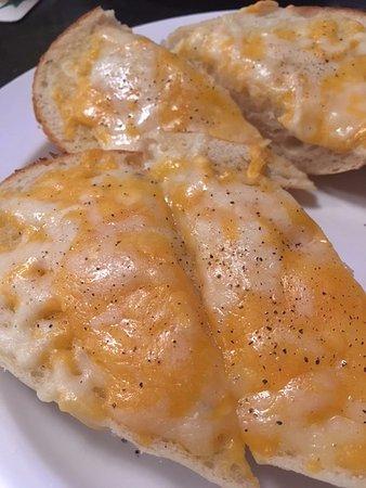 Oshawa, Canada: Soggy garlic bread. Paid for bacon but got none.
