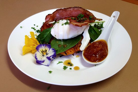 Orford, Australia: Sweet potato rosti topped with a poached egg and bacon drizzled with maple syrup
