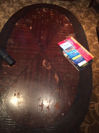 Holiday Inn Express Hotel & Suites Bethlehem Airport - Allentown Area: Stained threadbare sofaHorrible coffee table that needs to be tossed in the trash