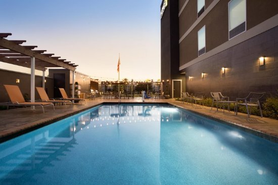 Webster, TX: Swimming Pool with Lounge Chairs Along Side