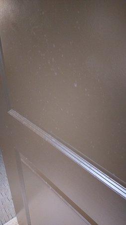 Watford City, ND: Water/Toothpaste spots on bathroom door