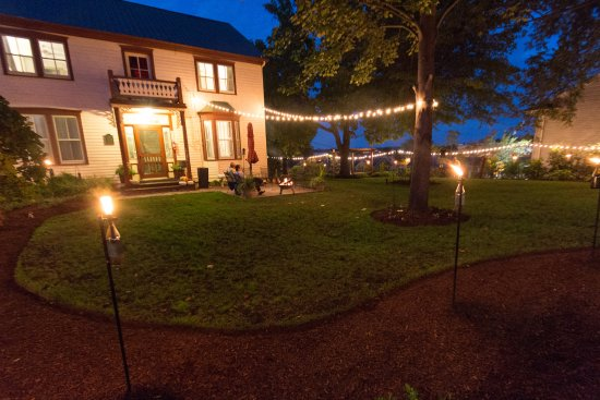 Captain Wohlt Inn: Our beautiful gardens have multiple seating areas and fire pits for guests to enjoy!