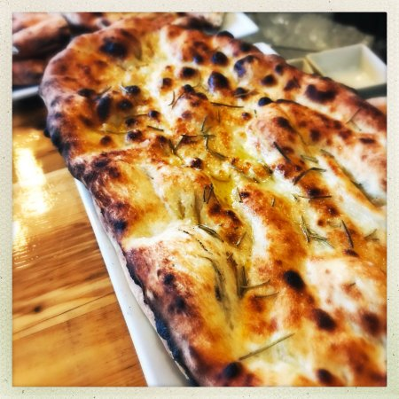 Needham, MA: At night, Chef Marisa's homemade foccacia warms bread baskets across the dining room.