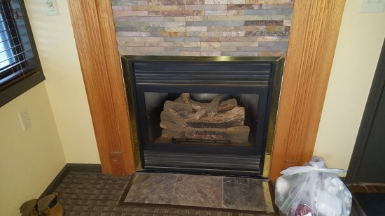 Christmas Mountain Village: Warm electric fireplace.