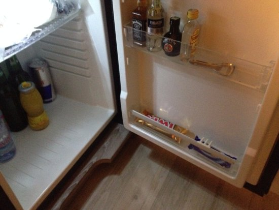 Estilo Fashion Hotel : Mini fridge filled with all types of very affordable prices for goodies