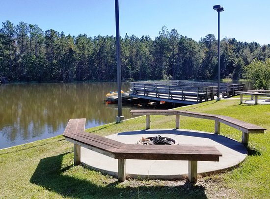 Brunswick, GA: Fire-pit Seating Areas next to Catch-and-Release Lake. Fishing Dock extends onto lake.