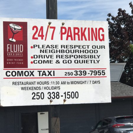 Parking signage, Respect the neighbourhood, Fluid Bar and Grill, 1175 Cliffe Ave, Courtenay, BC