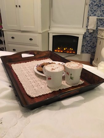 Dover, NH: How about some hot chocolate and cookies in front of your beautiful fireplace?