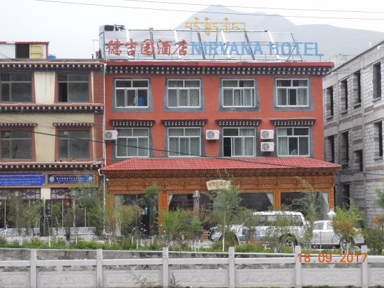 Xiahe County, China: View of hotel from across the river