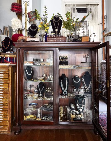 New York, NY: A case filled with Victorian, Art Deco, Midcentury, and Native American jewelry, cufflinks and b