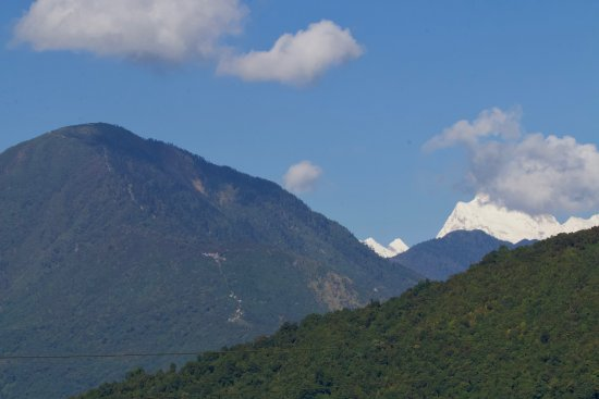 Taplejung, Nepal: Pathibhara hill from a distance with path showing