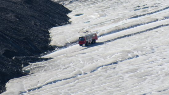 Icefields Parkway: Four wheel bus on glacier