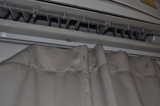 Nantra Silom: Dirt and dust from the AC on the curtains