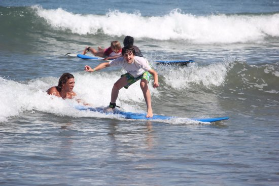 Playa Grande, Costa Rica: One of the surf guides giving our student a helping hand.