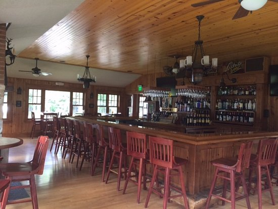 West Bend, WI: Bar with a view of the Big Cedar Lake and patio dining