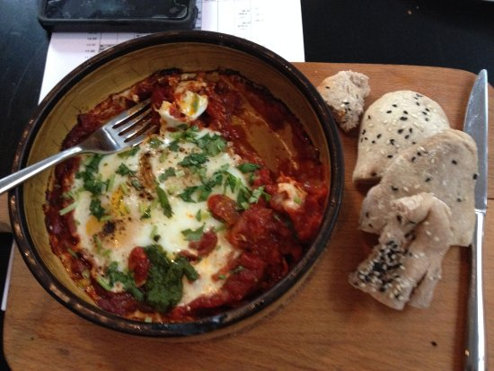 The Orchid Hotel: One of my delicious breakfasts: shakshouka and fresh baked rye flatbreads.