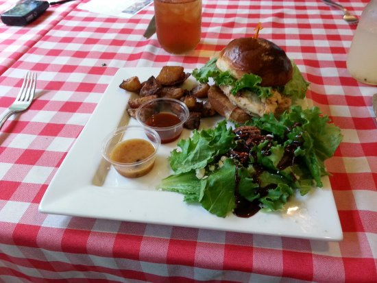 Paauilo, HI: Chicken with caramelized onions on a home-made bun. Salad with spiced pecans and feta cheese.
