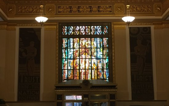 Drury Plaza Hotel San Antonio Riverwalk: The lobby has a stained glass window that depicts the Catheral of San Fernando