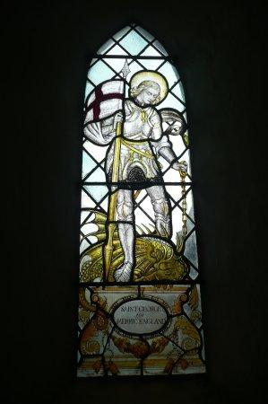 Elham, UK: window next to the church door