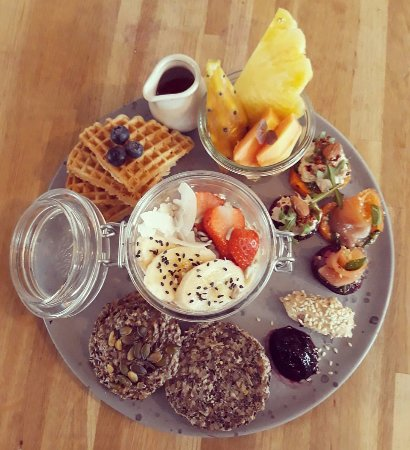 Valby, Denmark: BRUNCH PLATE: Overnight Oats; waffles, exotic fruits, stone-age bread, salmon and tuna bites.