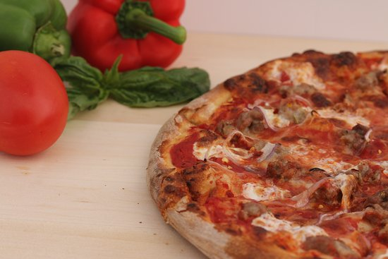 Westminster, CA: Renato's Pizzas are hand-rolled and our doughs are prepared fresh onsite daily