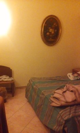 Hotel Archimede: This was taken from the opposite wall. Small room!