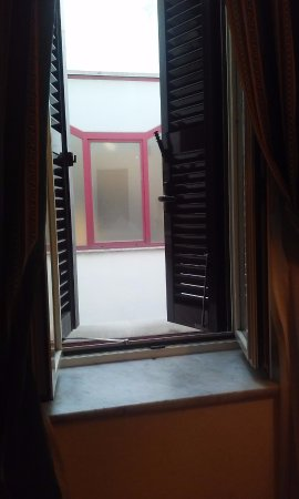 Hotel Archimede: Internal well of the building was the view. Opposite wall continued two further floors