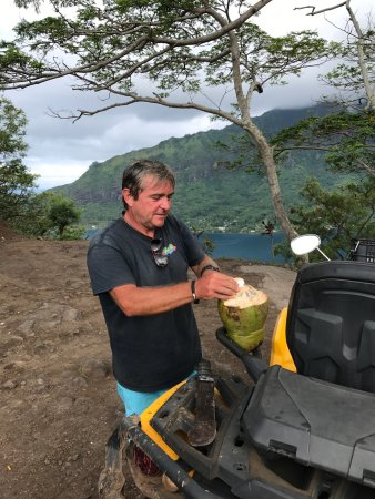Papetoai, French Polynesia: Missed a few from my review. The first couple of of Oliver cutting up our snack, and then a pic
