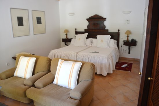 Finca Hotel Son Palou: Junior Suite #14 - comfortable bedroom with an adjoining seating area along with terrace.