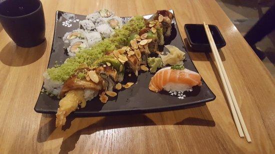 Champaign, IL : Alaskan, Alligator, and Cali Crunch rolls with one Salmon Toro Nigiri