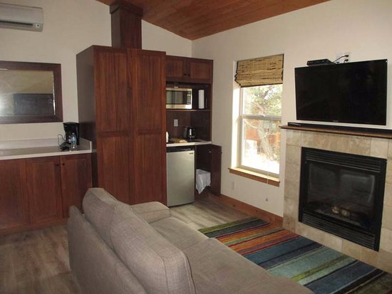 Tropic, UT: Living room with Murphy Bed, fridge, toaster, microwave