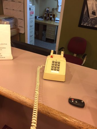 Columbia City, IN: With nobody at the front desk, a sign says to call staff on this phone.  Still nobody.