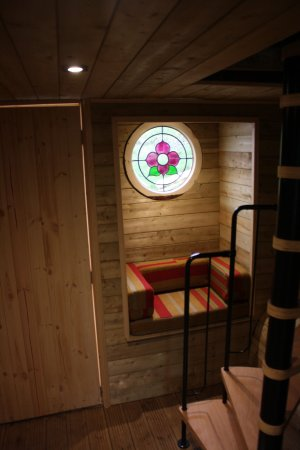"Abergele, UK: This is the ""wood cabin"" under ground space below the main yurt. With a beautiful window seat!"
