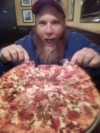 Elizabeth City, NC: After a hard day of  dangerous tree removal. Donnie of Burch Tree Service Love's Van's Pizza!