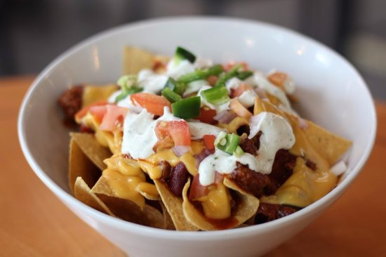 Woodbridge, VA: Loaded nachos, smothered in chili, peppers, onions, cheese, and cilantro crema.