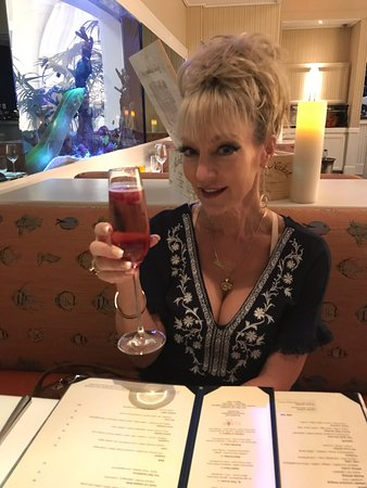Maritana Grille at The Don CeSar: Me enjoying the Pink Pearl Cocktail ( you can see their pet eel behind me)