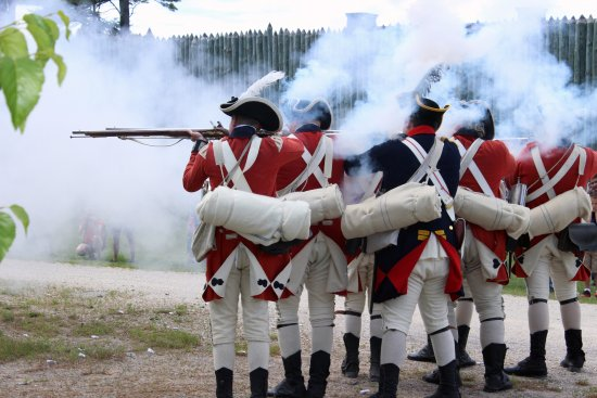 Mackinaw City, MI: Musket Firing Demonstration at Colonial Michilimackinac.