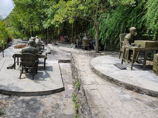 Fenghuang County, China: The garden is consists of a group of statues of chess players.